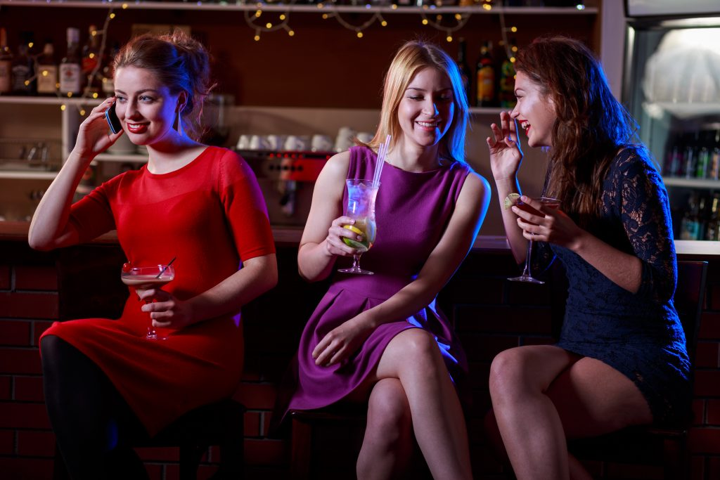 Girls talking and drinking