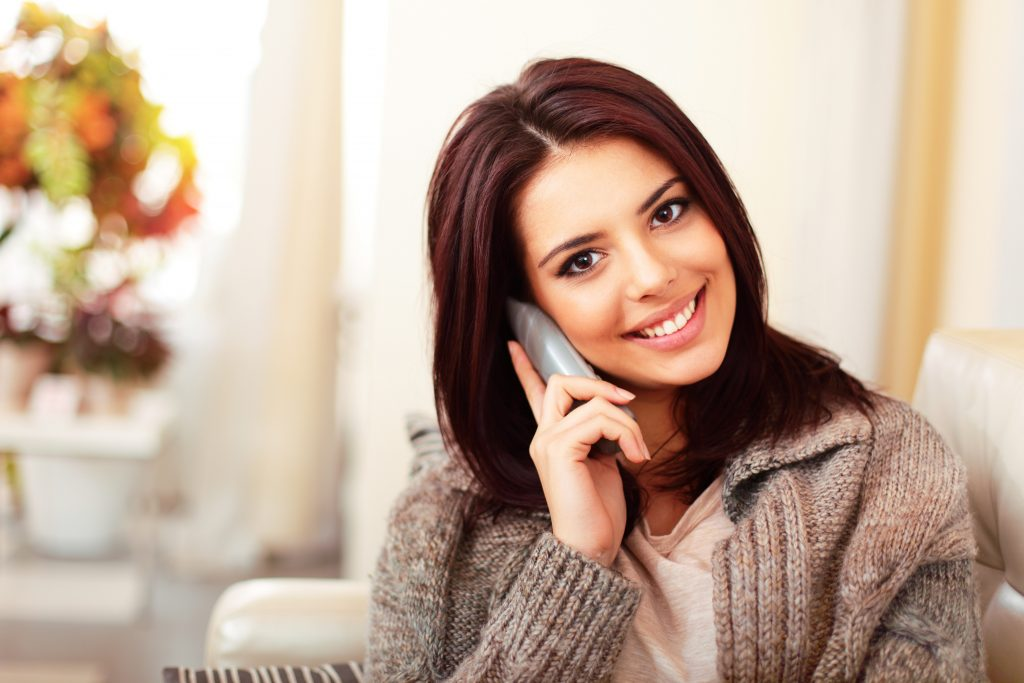 woman talking on phone to fm world prospect