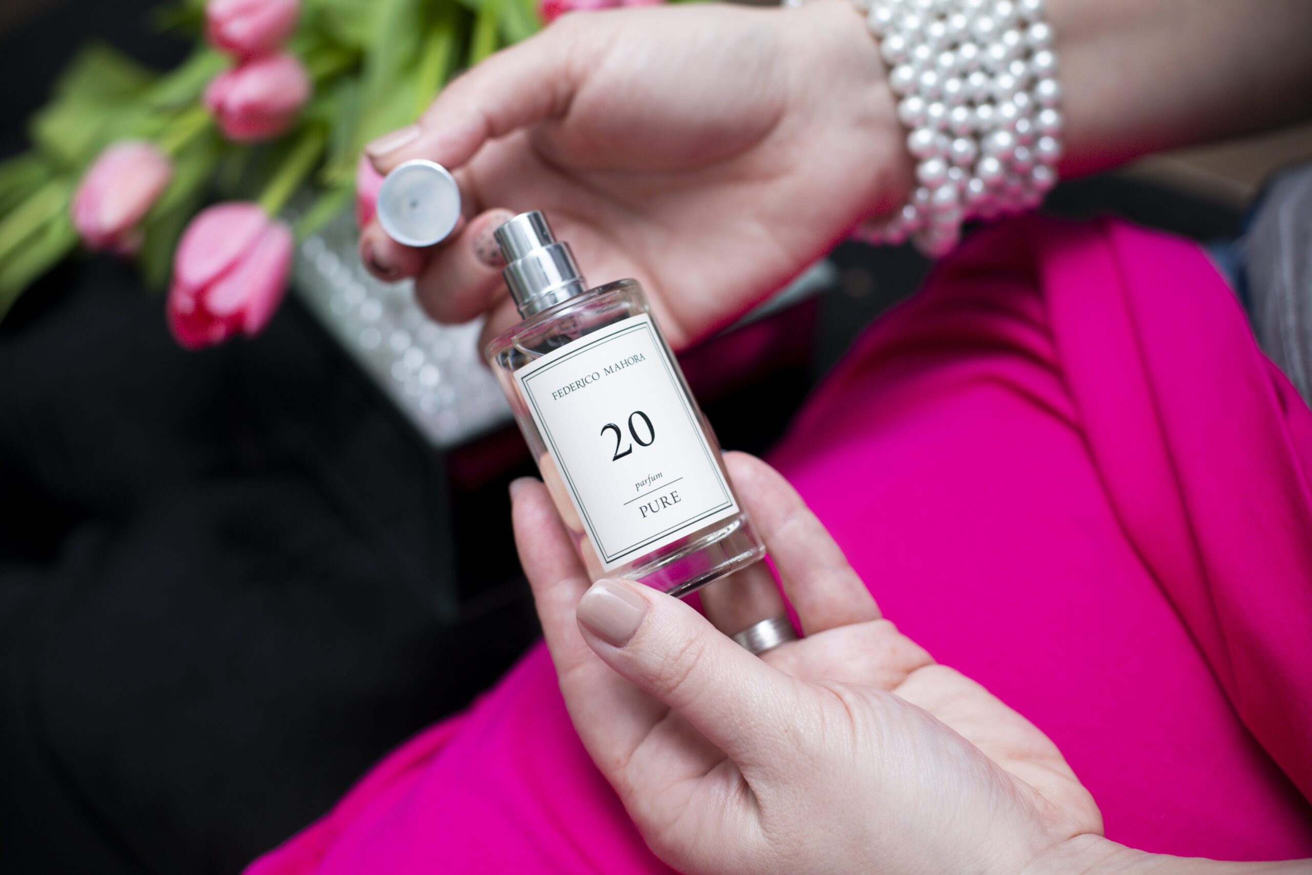woman opening bottle of pure fm perfume 20